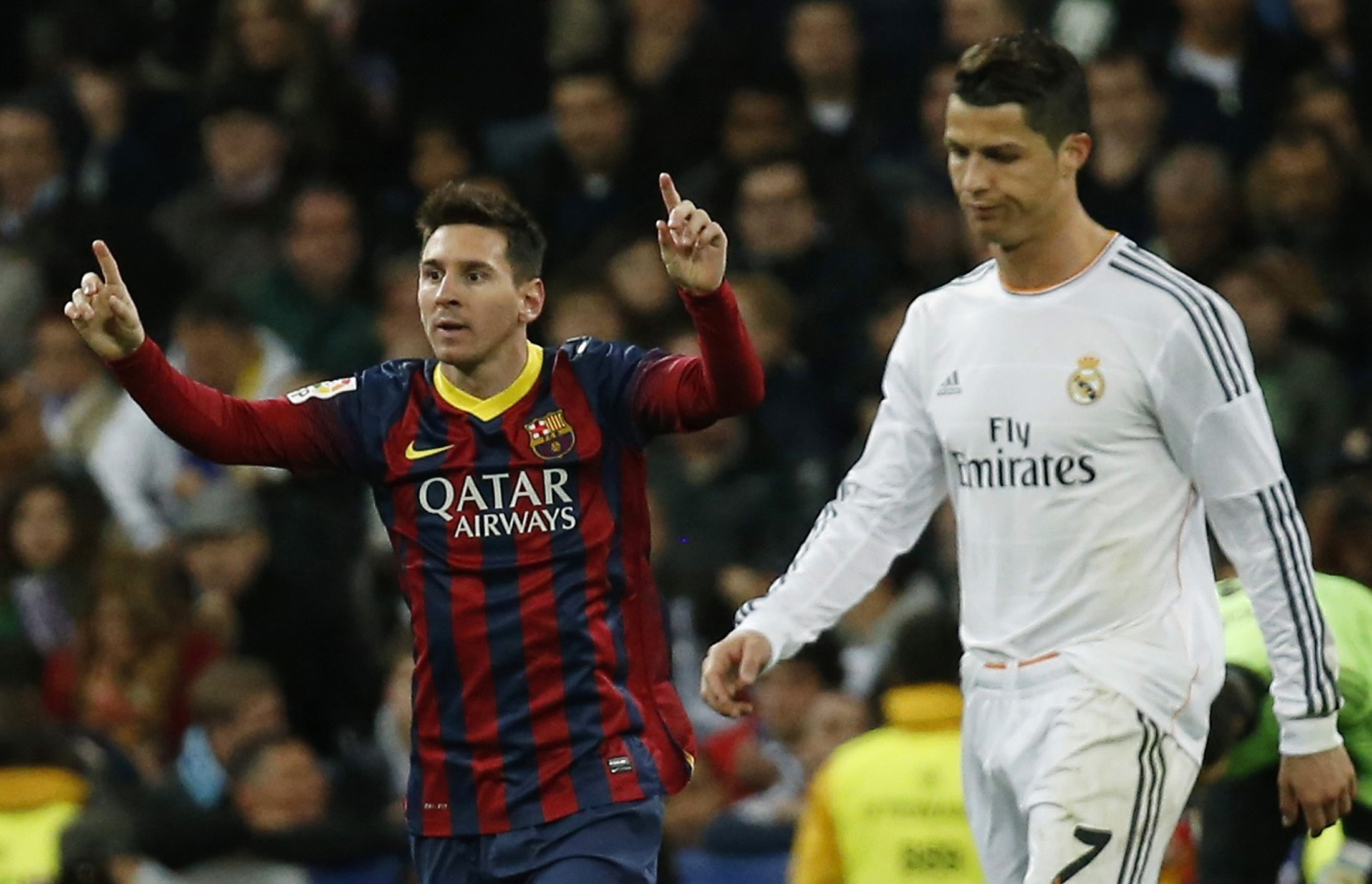 Barcelona's Lionel Messi celebrates a goal next to Real Madrid's Cristiano Ronaldo during La Liga's second 'Clasico' soccer match of the season in Madrid