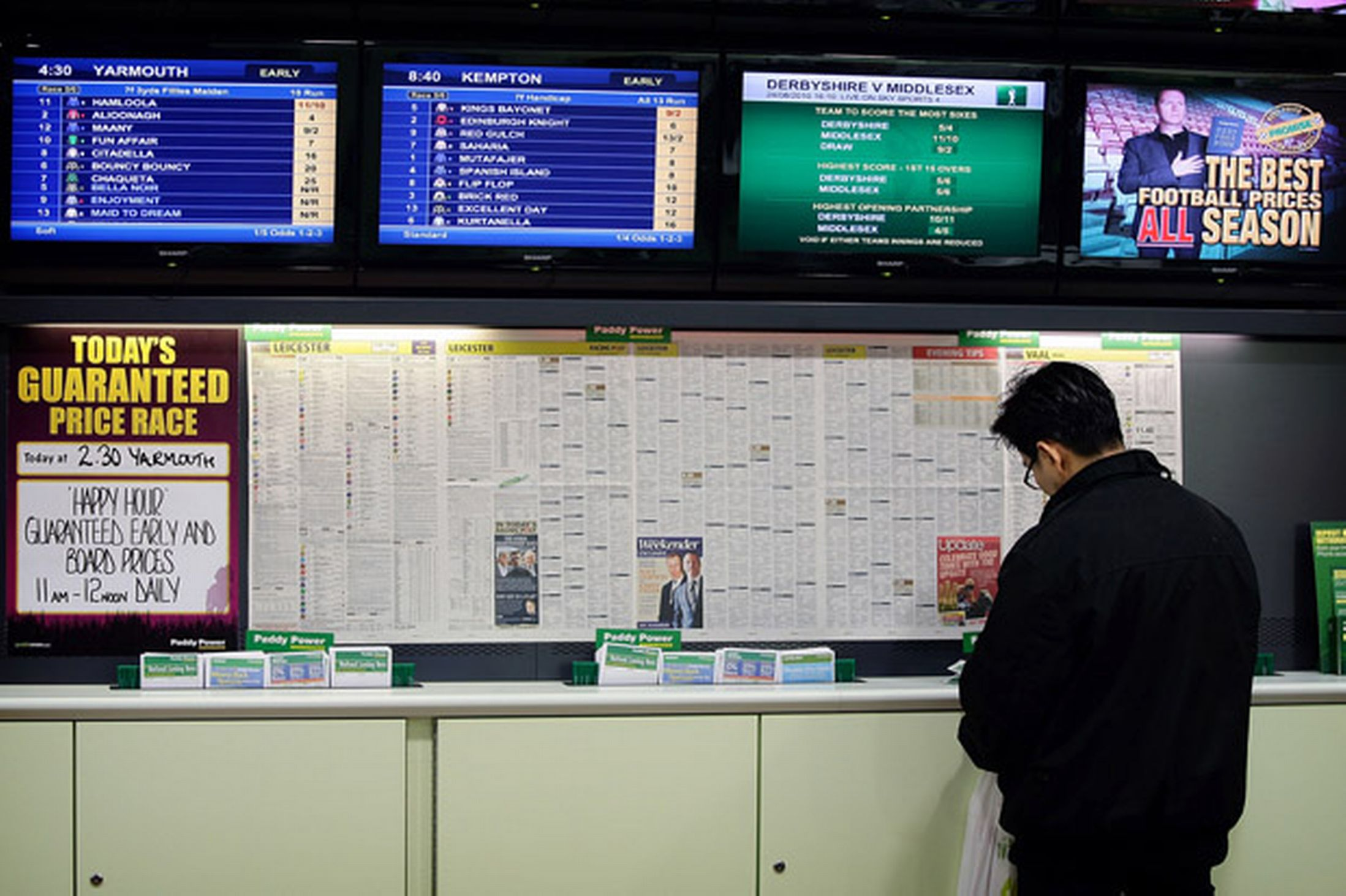 A-punter-in-a-bookmakers-places-a-bet